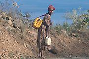 Woman on her way to a waterhole, Omovalley,Ethiopia,Africa