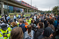 London, UK. 6 September, 2019. Climate activists block one of the two main access roads to ExCel London during Stop The Arms Fair protests on the fifth day of a week-long carnival of resistance against DSEI, the world's largest arms fair. The road remained blocked for several hours. The fifth day of protests was themed as Stop The Arms Fair: Stop Climate Change in order to highlight links between the fossil fuel and arms industries.