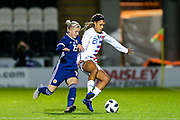Jessica McDonald (#21) of USA protects the ball from the challenge of Lana Clelland (#19) of Scotland during the Women's International Friendly match between Scotland Women and USA at Simple Digital Arena, Paisley, Scotland on 13 November 2018.
