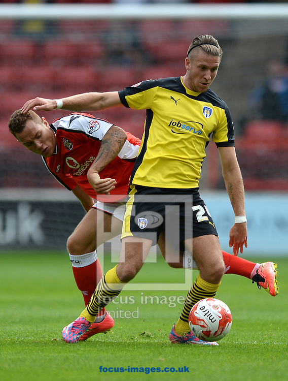 George Moncur of Colchester United does battle with  Kieron Morris of Walsall during the Sky Bet League 1 match between Walsall and Colchester United at the Banks's Stadium, Walsall<br /> Picture by Richard Blaxall/Focus Images Ltd +44 7853 364624<br /> 06/09/2014