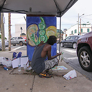 Artist Jaquanne L, Daniels applies acrylic paint to a control box while working on his piece &quot;Pass the Peas (Like we used to)&quot; Thursday, June 22, 2017, at West 4th Street in Wilmington Delaware.<br /> <br /> This is a collaboration of the City of Wilmington, Nemours &amp; West Side Grows Together along with the Smashed Label artists. <br /> <br /> The idea was West Side Grows and funding came from Nemours and they have tasked the artists with painting healthy habits or environments as the theme.