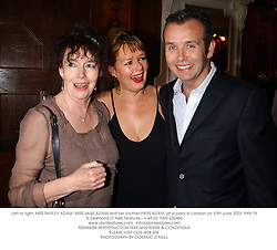 Left to right, MRS SHIRLEY ADAM, MISS JANE ADAM and her brother PIERS ADAM, at a party in London on 10th June 2003.PKH 15