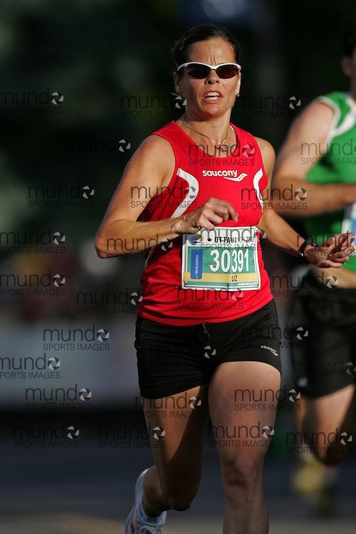 (Ottawa, ON --- May 29, 2010) LIZ MAGUIRE running in the 10km race during the Ottawa Race Weekend. Photograph copyright Sean Burges / Mundo Sport Images