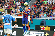 FC Barcelona midfielder Coutinho (7) goes up for a header in a game against SSC Napoli during a La Liga-Serie A Cup soccer match, Wednesday, Aug. 7, 2019, in Miami Gardens, Fla. FC Barcelona beat Napoli 2-1 (Kim Hukari/Image of Sport)