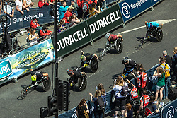 © Licensed to London News Pictures . 20/05/2018 . Manchester , UK . Athletes set off on Portland Street in Manchester City Centre at the start of the wheelchair race in the Great Manchester Run . A minute of silence is held ahead of the start of the race to mark the first anniversary of the Manchester Arena bombing , which killed 22 and seriously injured dozens more , at an Ariana Grande concert on 22nd May 2017 . Photo credit : Joel Goodman/LNP