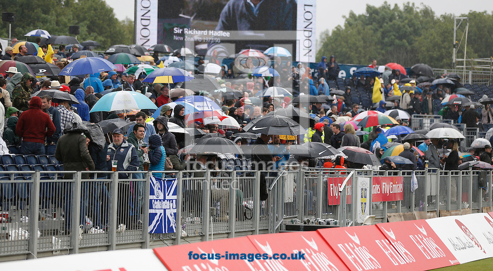 Fans take cover from the rain during the Royal London One Day Series match at Emirates Durham ICG, Chester-le-Street<br /> Picture by Simon Moore/Focus Images Ltd 07807 671782<br /> 20/06/2015
