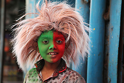 A happy moment of a boy in Holi festival in the street of Shakhari Bazaar, Dhaka, Bangladesh on 21, March'2019.