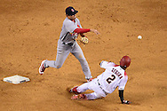 PHOENIX, ARIZONA - APRIL 27:  Aledmys Diaz #36 of the St. Louis Cardinals turns the double play over the sliding Jean Segura #2 of the Arizona Diamondbacks in the third inning at Chase Field on April 27, 2016 in Phoenix, Arizona.  (Photo by Jennifer Stewart/Getty Images)