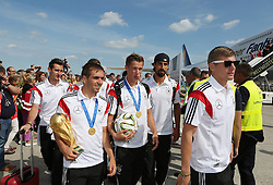15.07.2014, Flughafen Tegel, Berlin, GER, FIFA WM, Empfang der Weltmeister in Deutschland, Finale, im Bild vl. Miroslav Klose (GER), Philipp Lahm (GER) mit dem WM-Pokal, Erik Durm (GER), Sami Khedira (GER) und Toni Kroos (GER) // during Celebration of Team Germany for Champion of the FIFA Worldcup Brazil 2014 at the Flughafen Tegel in Berlin, Germany on 2014/07/15. EXPA Pictures © 2014, PhotoCredit: EXPA/ Eibner-Pressefoto/ Eibner Pressefoto / pool<br /> <br /> *****ATTENTION - OUT of GER*****