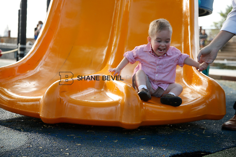 5/28/15 6:05:09 PM -- Miracle Miles and his family pose for portraits and play at the QuikTrip park for the 2015 Saint Francis Health System advertising campaign. <br /> <br /> Photo by Shane Bevel
