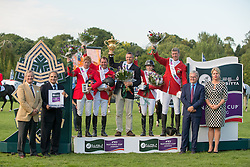 Germany, winners of the Furusiyya FEI Nations Cup of Great Britain Presented By Longines. On podium (L-R) Marcus Ehning, Hans-Deiter Dreher, Otto Becker (Chef d'equipe), Meredith Michaels-Beerbaum, Ludger Beerbaum. Accompanied by Andrew Finding (CEO British Equestrian Federation), Mozam Al Sheikh (Furusiyya representative), Richard Strohmeier (Longines) and Daisy Bunn (Hickstead) - Furusiyya FEI Nations Cup of Great Britain Presented By Longines  - Hickstead 2013