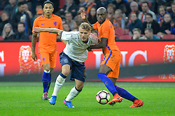 March 28, 2017 - Amsterdam, Netherlands - Ciro Immobile from Italy is challenged by Bruno Martins Indi from the Netherlands during the friendly match between Netherlands and Italy on March 28, 2017 at the Amsterdam ArenA in Amsterdam, Netherlands. (Credit Image: © Andy Astfalck/NurPhoto via ZUMA Press)