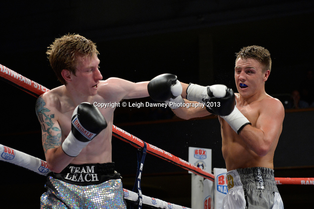 Jay Harris (white/silver shorts) defeats Ricky Leach in a Flyweight contest at Wolverhampton Civic Hall, Wolverhampton, 1st August 2014. Frank Warren in association with PJ Promotions.  © Credit: Leigh Dawney Photography.