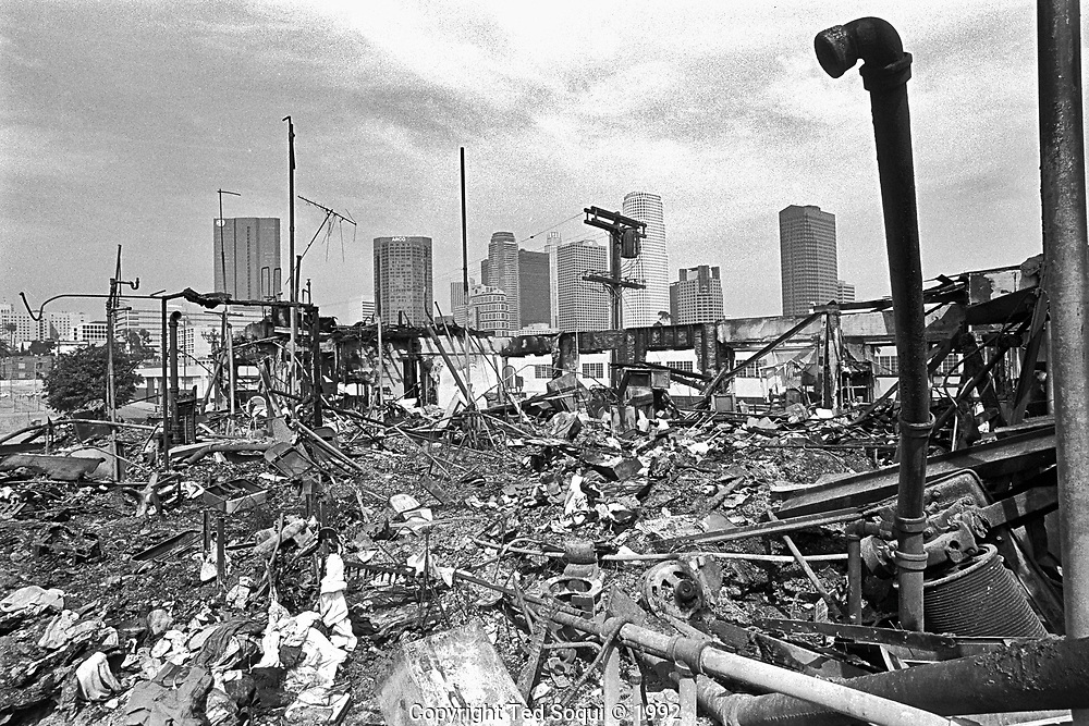 The skyline of downtown Los Angeles is seen in the background of a burned down apartment building in the Pico/Union area of Los Angeles.<br /> <br /> Los Angeles has undergone several days of rioting due to the acquittal of the LAPD officers who beat Rodney King.<br /> Hundreds of businesses were burned to the ground and over 55 people have been killed.