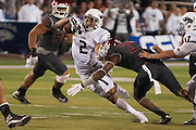Nevada's Richy Turner (2) tries to break a tackle from Washington State's Tracy Clark (22) during the second half of an NCAA college football game on Friday, Sept. 5, 2014 in Reno, Nev. Nevada defeated Washington State 24-13.<br /> (AP Photo/Kevin Clifford)
