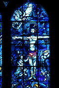 Central lancet of the stained glass windows created by Chagall with glassworker Charles Marq in 1974 depicting the crucifixion, axial chapel, Notre-Dame de Reims (Our Lady of Rheims), pictured on February 15, 2009, 13th - 15th century, Roman Catholic Cathedral where the kings of France were crowned, Reims, Champagne-Ardenne, France.