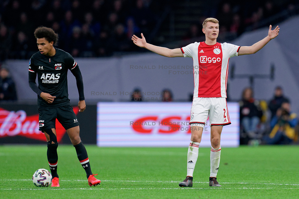 Perr Schuurs #2 of Ajax and Calvin Stengs #7 of AZ Alkmaar in action during the Dutch Eredivisie match round 25 between Ajax Amsterdam and AZ Alkmaar at the Johan Cruijff Arena on March 01, 2020 in Amsterdam, Netherlands