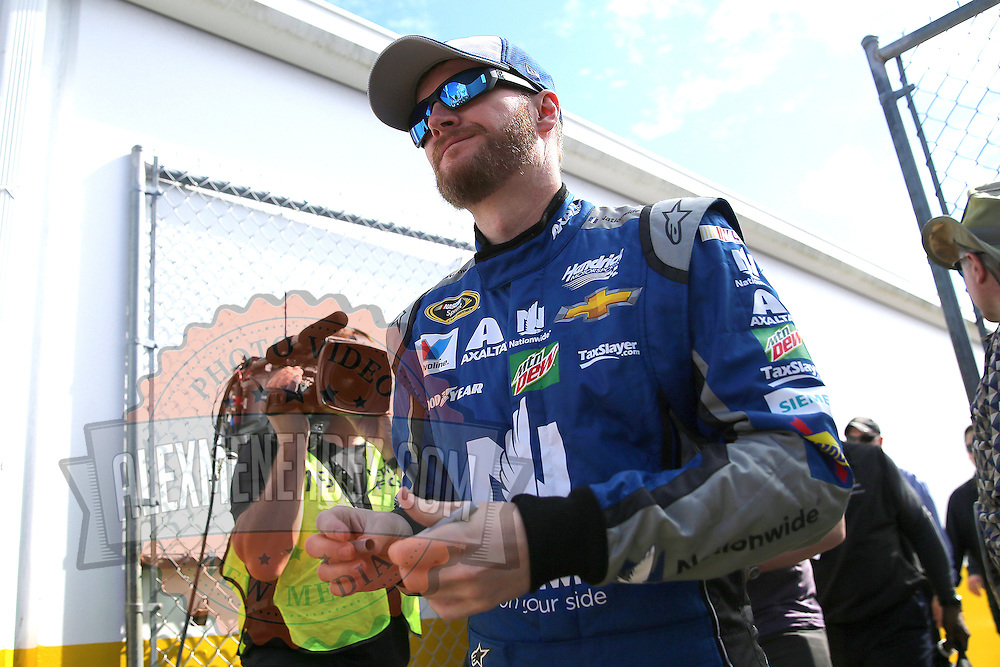 Race car driver Dale Earnhardt Jr. is seen as he makes his way to the drivers meeting prior to the 58th Annual NASCAR Daytona 500 auto race at Daytona International Speedway on Sunday, February 21, 2016 in Daytona Beach, Florida.  (Alex Menendez via AP)