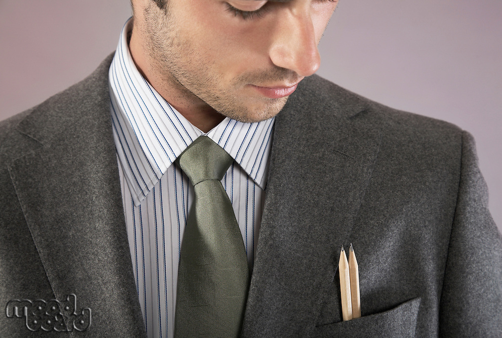 Young businessman with pencils in pocket portrait