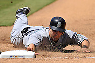 Seattle Mariners second basemen Willie Bloomquist (16) dives back safely to first base in the sixth inning against the Kansas City Royals at Kauffman Stadium. The Mariners defeated the Royals 4-3.