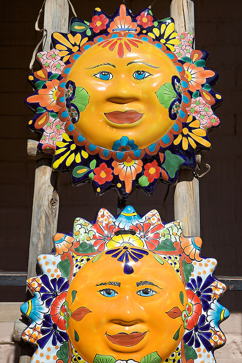 Colorful Southwest sun art on display in a gallery in Santa Fe, New Mexico.