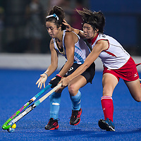 Kimika Hoshi (R) of Japan fight for the ball with Delfina Thome Guastavino (L) of Argentina in the Hockey 5s Women's Bronze Medal Match at Nanjing Olympic Sports Center Gymnasium during the Nanjing 2014  Youth Olympic Games in Nanjing, China 26 August 2014. The Nanjing Youth Olympic  Games 2014 runs from from 16 to 28 August  2014.