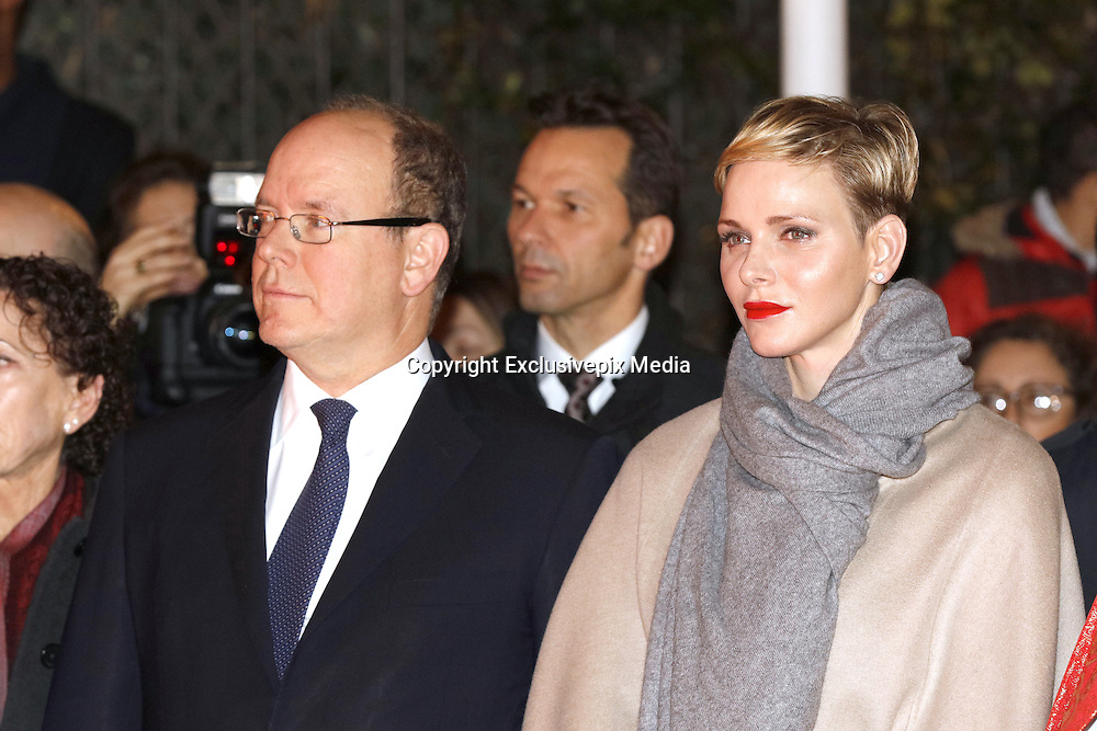 Well, she IS sparky: Princess Charlene honours Monaco's patron saint with Prince Albert by setting a fisherman's boat on fire in traditional ritual<br /> <br /> She marked her 38th birthday yesterday in characteristic low key style, and today Princess Charlene enjoyed celebrations of a different kinds as she f&ecirc;ted Monaco's patron saint.<br /> The royal stepped out with husband Prince Albert, 57, for the traditional remembrance service for St. Devote.<br /> St Devote's Day is a national holiday in Monaco in remembrance of their patron saint, a Christian martyr who was killed and tortured for her faith in the 4th century.<br /> <br /> The couple made their way through the crowds following a church service and stopped to shake hands with locals on their way.<br /> They also helped set light to a fishing boat - a tradition that's been going strong since the reign of Prince Louis II in 1942.<br /> <br /> According to legend, Christians saved St Devote's body and cast it off in a boat to Africa in the hope that once there she would receive a Christian burial.<br /> A dove then flew from her mouth and guided the boat to Monaco where it ran aground.<br /> <br /> The Saint is believed to have helped the principality in times of peril ever since.<br /> In line with the legend, Prince Albert and Princess Charlene took part in an annual ceremonial ritual remembering the Saint's final journey.<br /> They were given torches which they used to set fire to a fisherman's boat like the one that the Saint's body was carried on.<br /> Charlene looked elegant in a neutral colour palette for the occasion, teaming her nude coloured coat with voluminous sleeves with a pair of matching tawny suede knee boots. <br /> It's not the first time the Princess has chosen the footwear to complement her outfit for an important occasion. <br /> She previously sported the boots at the official presentation of her twins Prince Jacques and Princess Gabriella last January.   <br /> Charlene showed only a hint of her slim legs in a grey wool dress, which she matched with a large scarf in an indentical colour, a