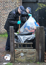© Licensed to London News Pictures. 02/04/2018. London, UK. Members of a police search team check dustbins in  gardens near Ellerton Road in Wandsworth, south west London, where 20 year old Devoy Stapleton was stabbed to death at 1am on Sunday 1st April - the 31st fatal stabbing this year in the capital. It is being reported that London's murder rate has overtaken New York's.   Photo credit: Peter Macdiarmid/LNP