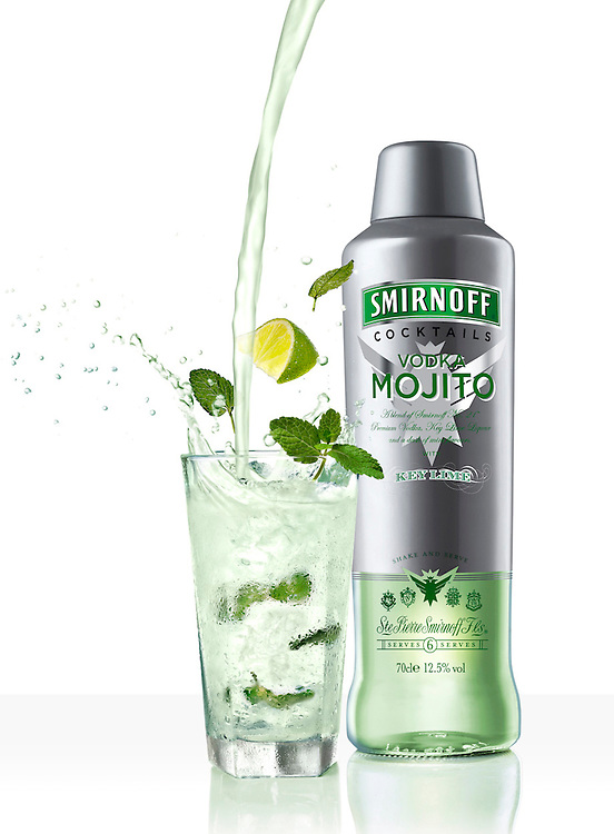 Smirnoff Mojito beauty packshot on white glossy background. Cocktail pouring into glass creating a splash with mint, lime and ice Ray Massey is an established, award winning, UK professional  photographer, shooting creative advertising and editorial images from his stunning studio in a converted church in Camden Town, London NW1. Ray Massey specialises in drinks and liquids, still life and hands, product, gymnastics, special effects (sfx) and location photography. He is particularly known for dynamic high speed action shots of pours, bubbles, splashes and explosions in beers, champagnes, sodas, cocktails and beverages of all descriptions, as well as perfumes, paint, ink, water – even ice! Ray Massey works throughout the world with advertising agencies, designers, design groups, PR companies and directly with clients. He regularly manages the entire creative process, including post-production composition, manipulation and retouching, working with his team of retouchers to produce final images ready for publication.