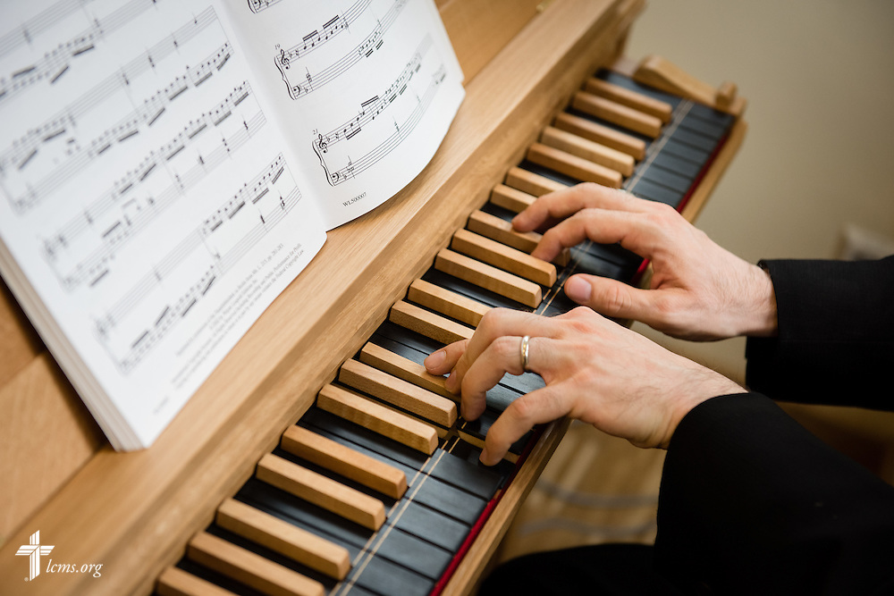 The Rev. Dr. Christopher Ahlman, LCMS missionary in Leipzig, Germany, performs on a new organ during the dedication of The International Lutheran Center at the Old Latin School on Sunday, May 3, 2015, in Wittenberg, Germany. LCMS Communications/Erik M. Lunsford