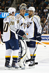 March 8, 2011; San Jose, CA, USA;  Nashville Predators defenseman Ryan Suter (20), goalie Pekka Rinne (35) and defenseman Shea Weber (6) during a stoppage in play during the first period against the San Jose Sharks at HP Pavilion. San Jose defeated Nashville 3-2 in overtime. Mandatory Credit: Jason O. Watson / US PRESSWIRE