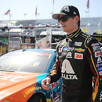 Sprint Cup Series driver Jeff Gordon (24) walks to his car during the 57th Annual NASCAR Coke Zero 400 practice session at Daytona International Speedway on Friday, July 3, 2015 in Daytona Beach, Florida.  (AP Photo/Alex Menendez)