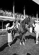 Harvey Smith, leading rider of the winning Great Britain team at the Dublin Horse Show in the RDS, Ballsbridge, Dublin, accepts the Aga Khan team trophy from Mrs Hely Hutchinson.<br />