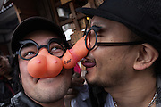 Japanese men wearing joke glasses with a penis and breast nose pieces during the Kanamara Matsuri, (Festival of the Steel Phallus). Kawasaki Daishi, Kanagawa, Japan. Sunday April 3rd 2016. The famous Kawasaki Penis Festival started in 1977 as a small festival to celebrate an old legend about the defeat of a penis eating demon. Today the festival is a huge draw for Japanese and foreign tourists and raises money for HIV and AIDS research.