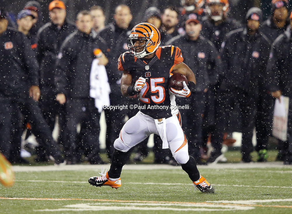 Cincinnati Bengals running back Giovani Bernard (25) turns to look for running room after catching a pass and before getting hit hard by Pittsburgh Steelers inside linebacker Ryan Shazier (50) causing a third quarter fumble, recovered by Shazier, and starting a player melee over no penalty call for unnecessary roughness and leading with the helmet during the NFL AFC Wild Card playoff football game against the Pittsburgh Steelers on Saturday, Jan. 9, 2016 in Cincinnati. The Steelers won the game 18-16. (©Paul Anthony Spinelli)