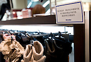 A sign in Mandarin is attached to the shelves for shoppers from China at the Matsuzakaya department store in the Ginza district of Tokyo, Japan on Tuesday 16 Nov. 2010..Photographer: Robert Gilhooly