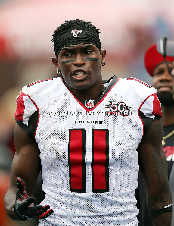 Atlanta Falcons wide receiver Julio Jones (11) talks to a coach on the sideline during the 2015 week 7 regular season NFL football game against the Tennessee Titans on Sunday, Oct. 25, 2015 in Nashville, Tenn. The Falcons won the game 10-7. (©Paul Anthony Spinelli)