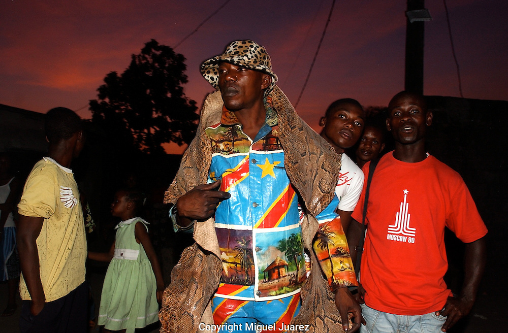 Papa Griffe, a leading sapeur and singer in the Congolese capital of  <br /> Kinshasa, is attempting to transform himself into the next Niarkos,  <br /> one of Congo's legendary rumba singers and sapeurs. As he walked  <br /> through the dirt-paths of his Kinshasa neighborhood, street boys  <br /> yelled out: &quot;Papa Griffe! He's a son of Europe! He's an  <br /> apostle!&quot; (PHOTO: MIGUEL JUAREZ).
