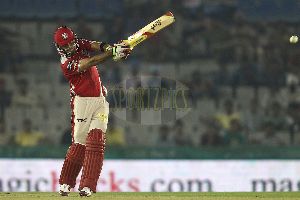 Glenn Maxwell of the Kings XI Punjab hits over the top for a boundary during match 2 of the Oppo Champions League Twenty20 between the Kings XI Punjab and the Hobart Hurricanes held at the Punjab Cricket Association Stadium, Mohali, India on the 18th September 2014<br /> <br /> Photo by:  Shaun Roy / Sportzpics/ CLT20<br /> <br /> <br /> Image use is subject to the terms and conditions as laid out by the BCCI/ CLT20.  The terms and conditions can be downloaded here:<br /> <br /> http://sportzpics.photoshelter.com/gallery/CLT20-Image-Terms-and-Conditions-2014/G0000IfNJn535VPU/C0000QhhKadWcjYs