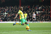 Norwich City midfielder Youssuf Mulumbu (18) with a shot on goal during the EFL Sky Bet Championship match between Brentford and Norwich City at Griffin Park, London, England on 31 December 2016. Photo by Matthew Redman.