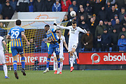 Wolverhampton Wanderers midfielder Romain Saiss (27) heads clear from Shrewsbury Town's James Bolton during the The FA Cup fourth round match between Shrewsbury Town and Wolverhampton Wanderers at Greenhous Meadow, Shrewsbury, England on 26 January 2019.