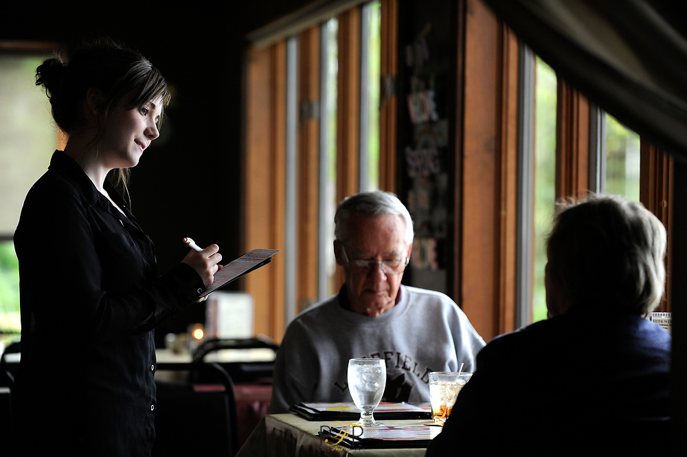 Waitress Nikita Pickart takes the order of Mark and Lois Weber of Appleton as she waits on them at Jim and Linda's Supper Club in Pipe.  Friday,  May 17,  2013. Patrick Flood/The Reporter Media.