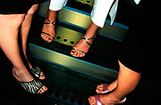 Close-up of three girls feets, wearing heels, UK 2000's