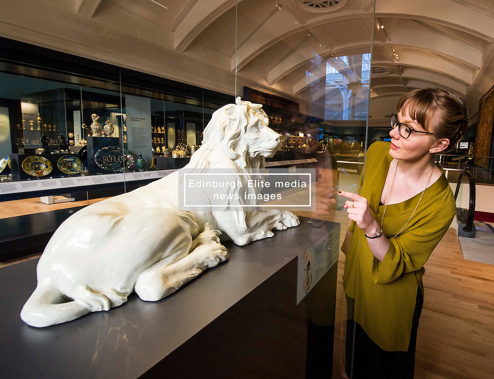 Pictured: Assitant curator European Decorative Arts, Dr Rachel King admires the ceramic Meissen Lion from c 1732-35<br /> <br /> The National Museum of Scotland will launch ten new galleries on 8 July following a £14.1 million redevelopment in their 150th year.  <br /> <br /> Ger Harley | EEm 5 July 2016