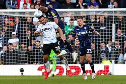 Mason Bennett of Derby County and Liam Cooper of Leeds United jump to head the ball - Mandatory by-line: Ryan Crockett/JMP - 11/05/2019 - FOOTBALL - Pride Park Stadium - Derby, England - Derby County v Leeds United - Sky Bet Championship Play-off Semi Final 1st Leg