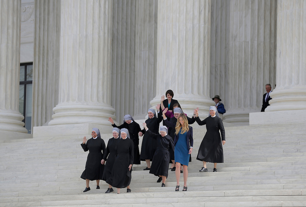 Nuns with Little Sisters of the Poor wave after Zubik v. Burwell, an appeal brought by Christian groups demanding full exemption from the requirement to provide insurance covering contraception under the Affordable Care Act, was heard by the U.S. Supreme Court in Washington March 23, 2016.      REUTERS/Joshua Roberts
