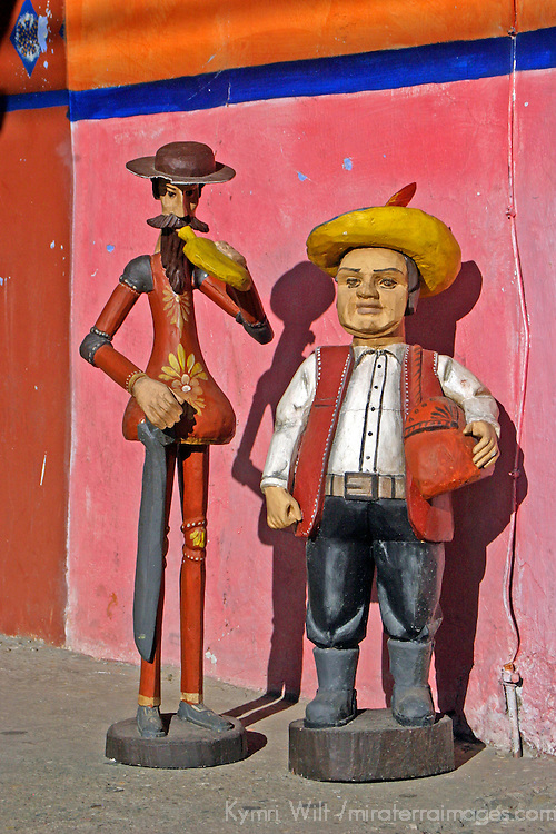 Americas, Mexico, La Velencia. Carved and painted wooden figures are sold near the La Valencia church, A UNESCO World Heritage site.