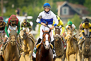 Jesus Castanon beams as he rides Shackleford across the finish line in the horse's victory in the Preakness Stakes in Baltimore.