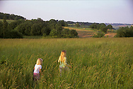 Young girl playing in the countryside in the gers , france