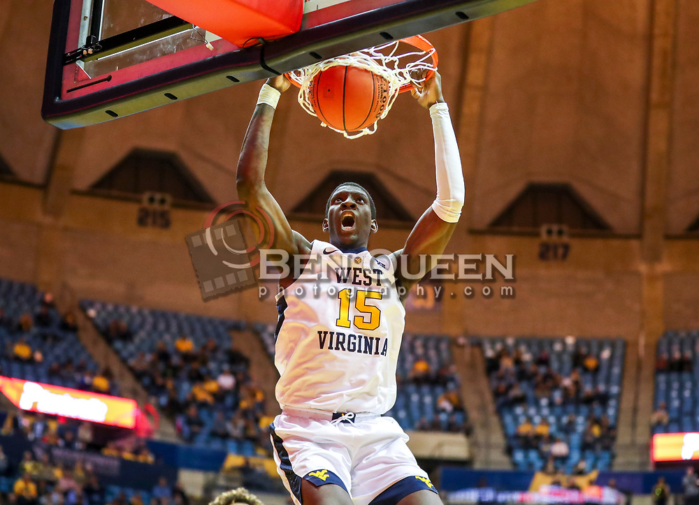 Nov 28, 2018; Morgantown, WV, USA; West Virginia Mountaineers forward Lamont West (15) dunks the ball during the second half against the Rider Broncs at WVU Coliseum. Mandatory Credit: Ben Queen-USA TODAY Sports